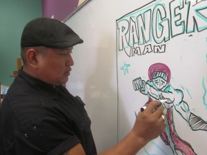 "Eddy, copying Theo's ""Ranger Man"" onto the big board."
