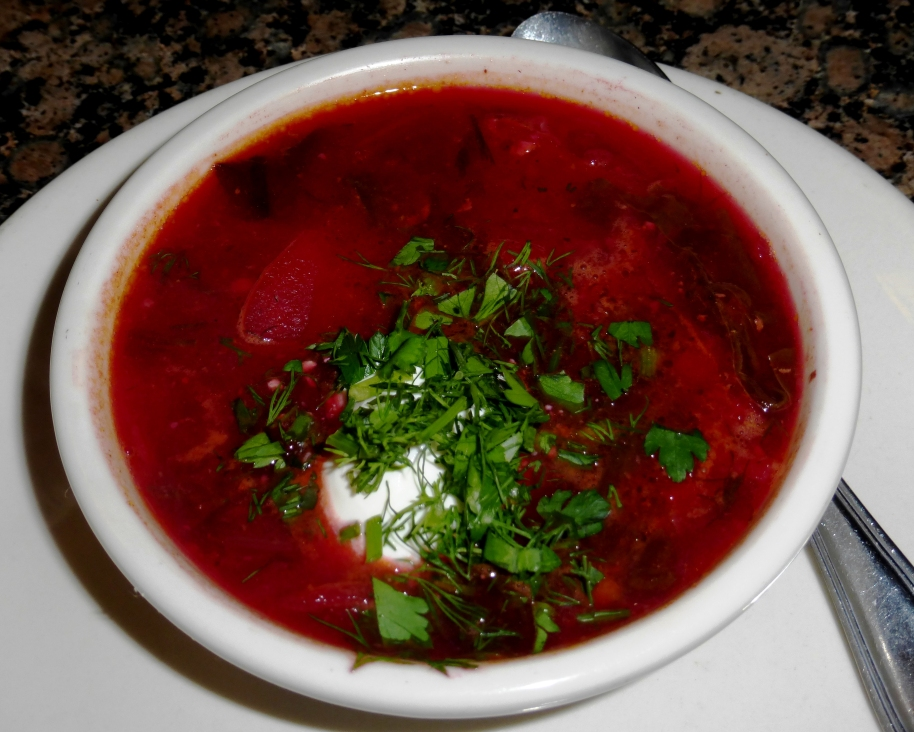 "Pomegranate Russian-Georgian Restaurant ""Russian Borscht: Deep reddish-purple beetroot soup with beef simmered for hours to produce culinary magic."""