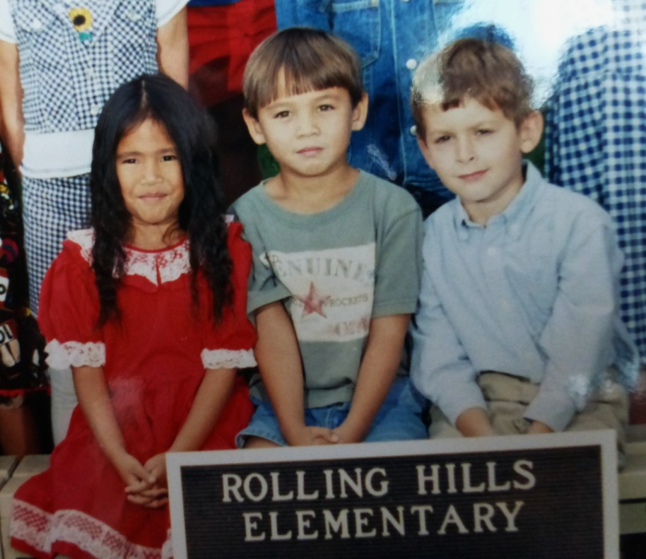 That cute little boy in the middle is officially grown up now... if graduating from college makes it official?