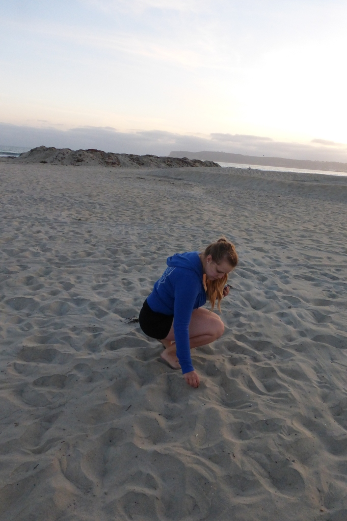 Albuquerque girl Patricia soaks up some ocean air and gets sand in her toes