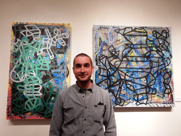 Christopher MacQueen, N4th Gallery Co-coordinator, Exploratory Arts Staff  and painter. Christopher focuses on connecting straight and curved lines; they're elemental shapes that can dictate the course of the painting.