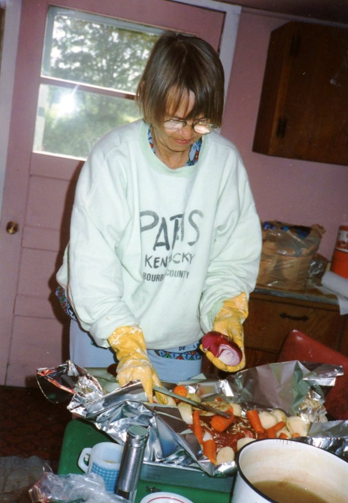 "I LOOKED FOR PICS OF ME COOKING THANKSGIVING DINNER. NONE TO BE FOUND. DID FIND 3 PHOTOS ALTOGETHER OF ME IN A KITCHEN. HERE'S ONE. MINNESOTA, THE SUMMER i SEMI-CAMPED OUT IN ""THE OLD PLACE."""