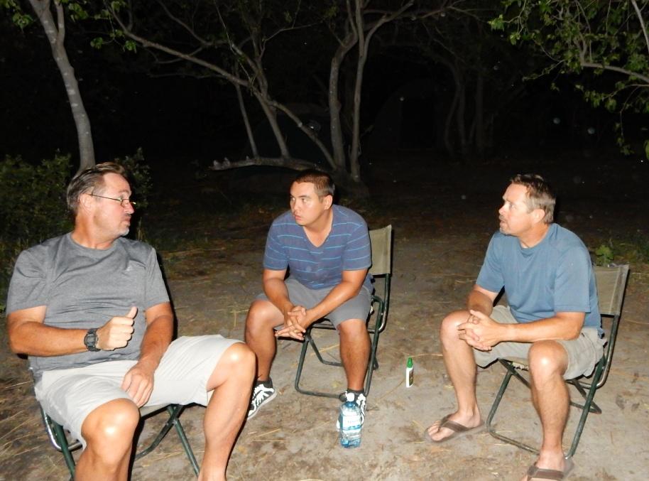 The Boys in the Family: Scott, son Steven, bro Steven. In the dark Botswana night.